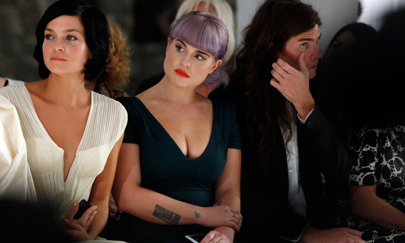 Actress Kelly Osbourne and her fiance Matthew Mosshart (Right) watch models present creations from Zac Posen's Spring/Summer 2014 collection during New York Fashion Week. – Photo by Reuters