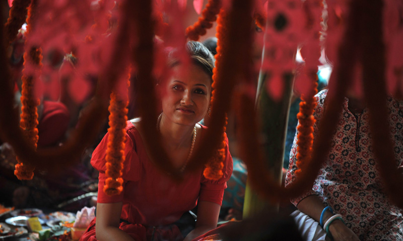 The three-day long Teej festival, is celebrated by Hindu women in Nepal and some parts of India. Unmarried women wish for handsome husbands and happy conjugal lives. – Photo by AFP
