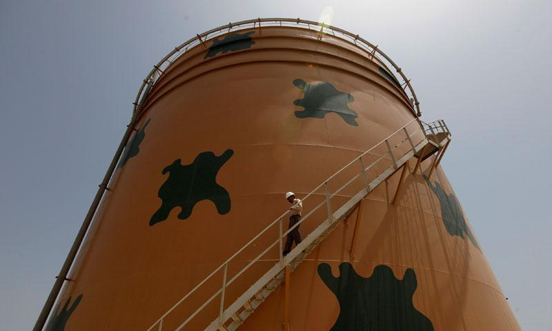 An employee walks down from the tank at the Bin Qasim Power Station (BQPS-II), some 35 kilometers from east of Karachi city on June 20, 2013.—Reuters Photo