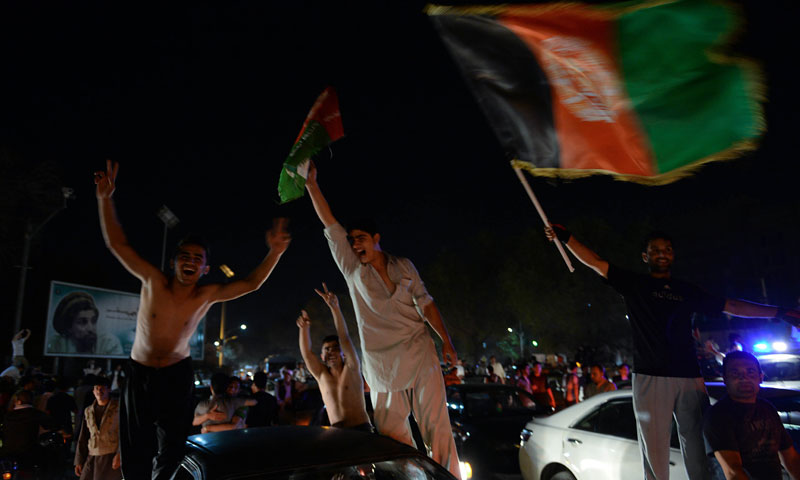 Afghan fans of football celebrate winning the SAFF Championship 2013 trophy after their team defeated India during the final match, in the streets of Kabul on September 11, 2013. – AFP Photo