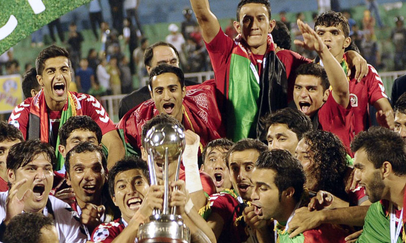 Afghanistan's players celebrate with the trophy, following their victory over India in the SAFF Championship football Cup final match in Kathmandu on September 11, 2013. Afghanistan won the match 2-0. – AFP Photo
