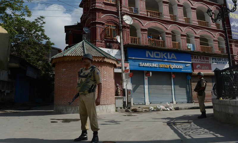 Indian paramilitary soldiers stand guard during a one day shutdown in Srinagar on July 1, 2013.—Photo by AFP