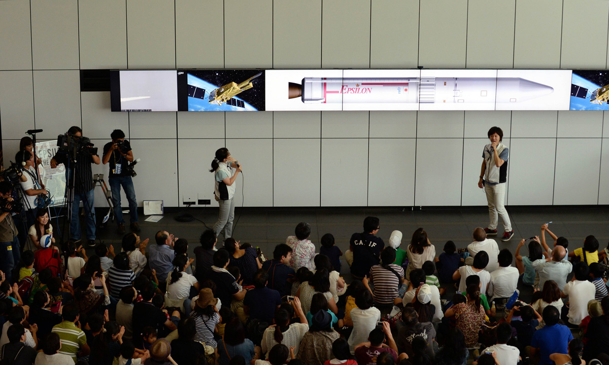 Guests gather to watch a projected live transmission of the launch. – Photo by AFP
