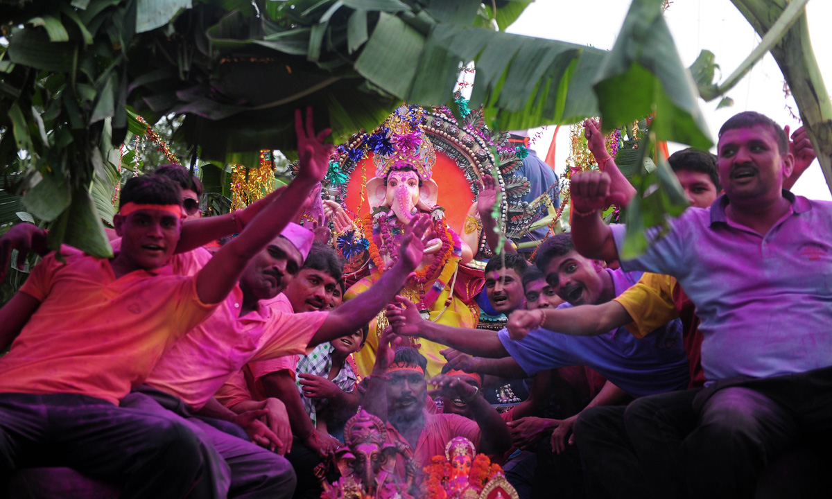Indian army members transport an idol of the elephant-headed Hindu god Ganesha, in an army truck for immersion in the Sangam, the confluence of the Yamuna and Ganges river, during the Ganesh Chaturthi festival in Allahabad. – Photo by AFP