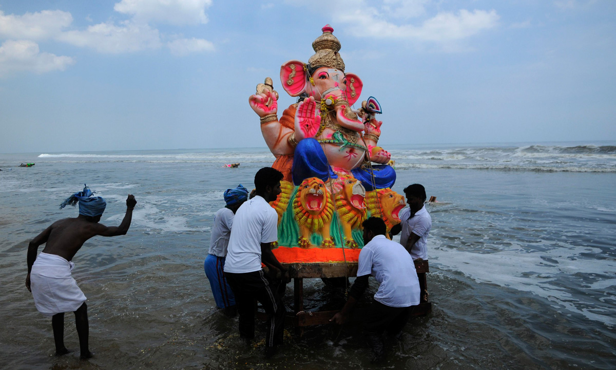 Devotees carry an idol of the Hindu god Ganesh, the deity of prosperity, into the Bay of Bengal for its immersion during the ten-day-long Ganesh Chaturthi festival, in the southern Indian city of Chennai. – Photo by Reuters