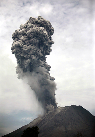 Mount Sinabung spews volcanic materials into the air as it erupts in Karo. - Photo by AP