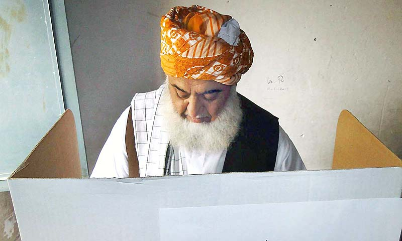 Chief of JUI-F, Maulana Fazalur Rehman cast his vote during by-election in constituency NA-25.— Photo by APP