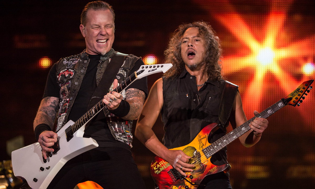 James Hetfield (Left) and Kirk Hammett of Metallica rock the stage.