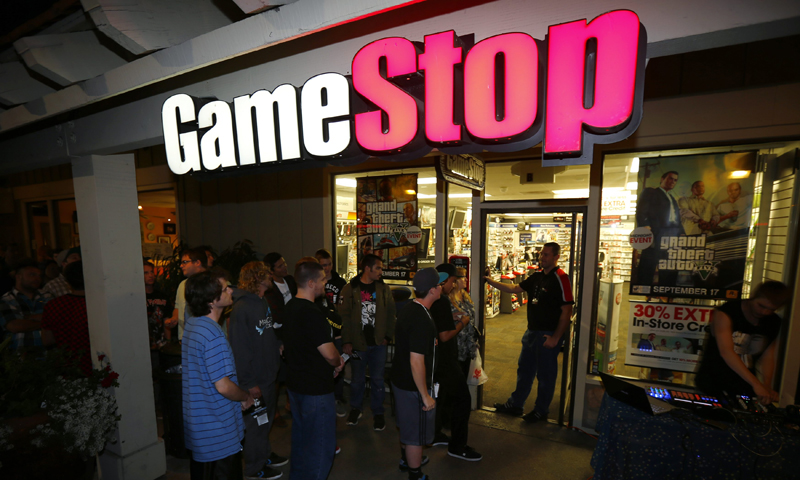 """Gaming enthusiasts wait till midnight at a local Game Stop gaming store to purchase the latest release of """"Grand Theft Auto Five"""" in Encinitas, California September 16, 2013. — Reuters Photo"""