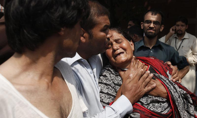 A Christian woman mourns the death of her son at the site of a suicide blast at a church in Peshawar September 22, 2013. — Photo Reuters