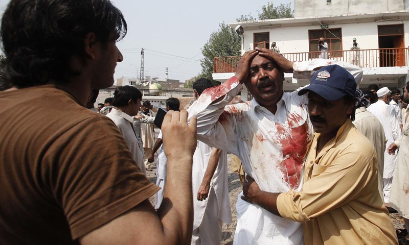 A man cries at the death of his brother at the site of a suicide blast at a church in Peshawar, September 22, 2013.  At least 40 people were killed and 70 wounded on Sunday in a suicide bomb attack on a church in the Pakistani city of Peshawar, a local government official said. — Photo Reuters