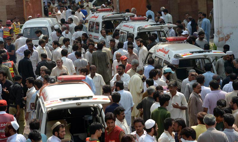 Ambulances are parked outside the Church after two suicide bomb attacks in Peshawar on September 22, 2013.  A double suicide bombing killed more than 60 people at a church service in northwest Pakistan, officials said, the deadliest ever attack on Christians in the troubled country.  — Photo AFP