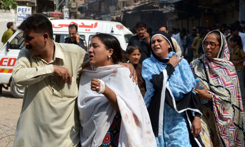 Pakistani Christians react after the killing of their relatives following two suicide bomb attacks on a Church in Peshawar. -AFP Photo
