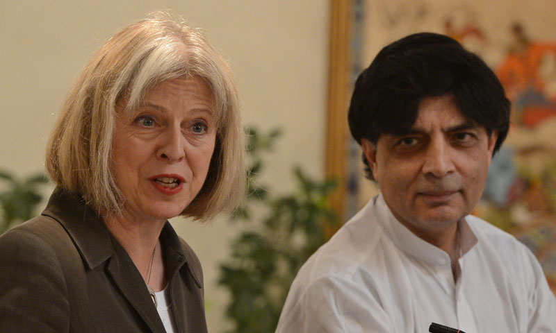 British Home Secretary Theresa May (L) and Interior Minister Chaudhry Nisar (R) speak to the media in a meeting in Islamabad on September 24, 2013. – AFP Photo