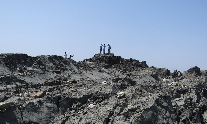 The National Institute of Oceanography has sent a team to survey the island, which stands about 20 metres (70 feet) high. —AFP PHOTO/ Pakistan Government