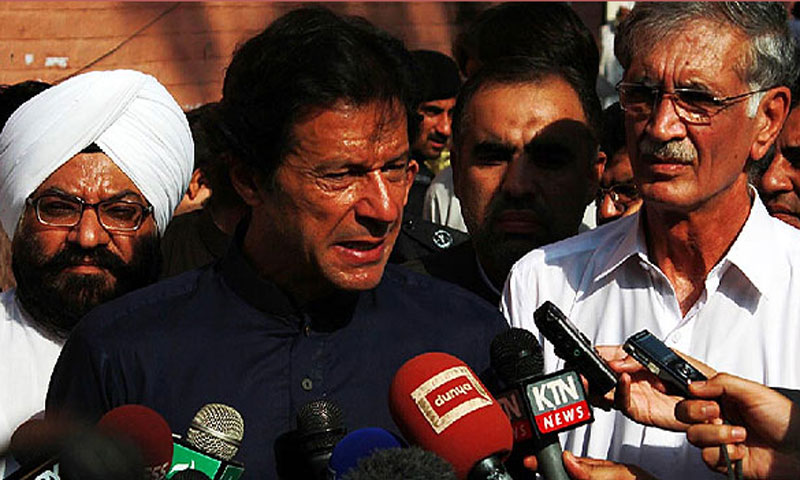 PTI chairman Imran Khan speaking to media representatives after visiting injured persons of the Peshawar church bombing at the Lady Reading Hospital. — Online photo