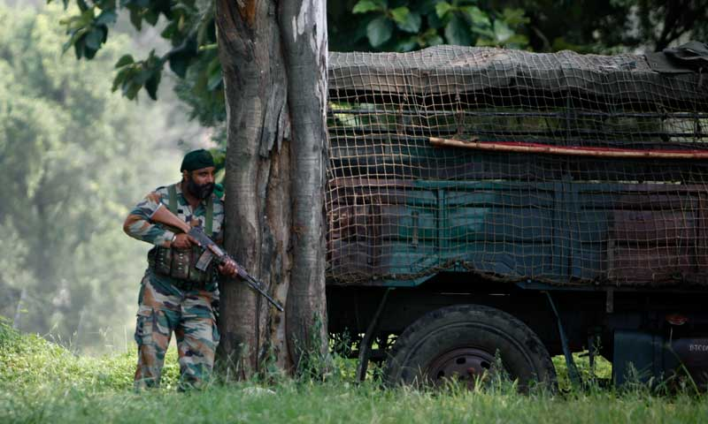 An Indian army soldier takes position during an attack on an army camp in Samba, about 40 kilometres from Jammu, September 26, 2013. — Photo by AP