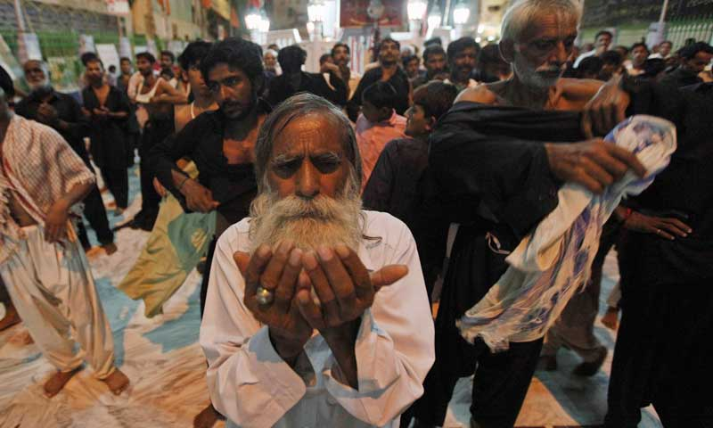 A devotee prays at the shrine of Sufi saint Syed Usman Marwandi, also known as Lal Shahbaz Qalandar, in Sehwan Sharif, September 5, 2013. — Photo by Reuters