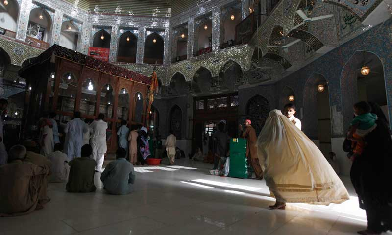 A woman clad in burqa walks in the hallway of the tomb of Sufi saint Syed Usman Marwandi, also known as Lal Shahbaz Qalandar, in Sehwan Sharif, September 5, 2013.  — Photo by Reuters