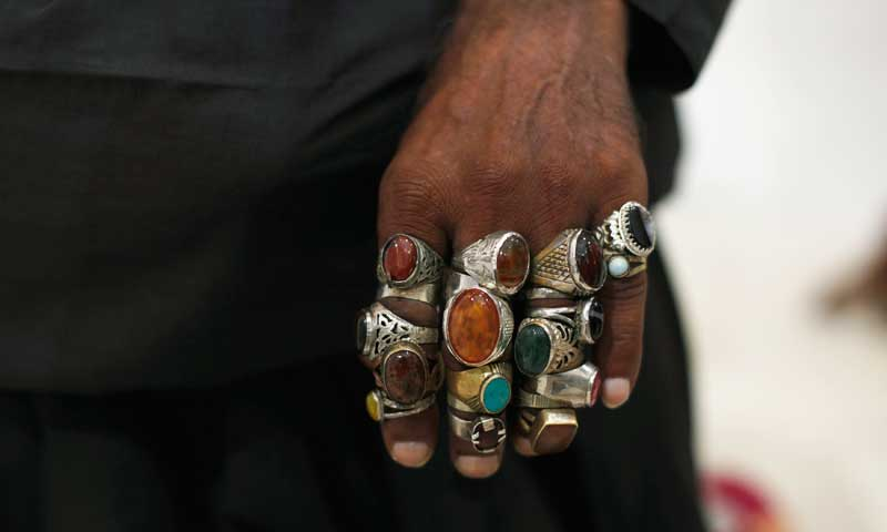 A devotee's hand is pictured decorated with rings at the tomb of Sufi saint Syed Usman Marwandi, also known as Lal Shahbaz Qalandar, in Sehwan Sharif, September 4, 2013. — Photo by Reuters
