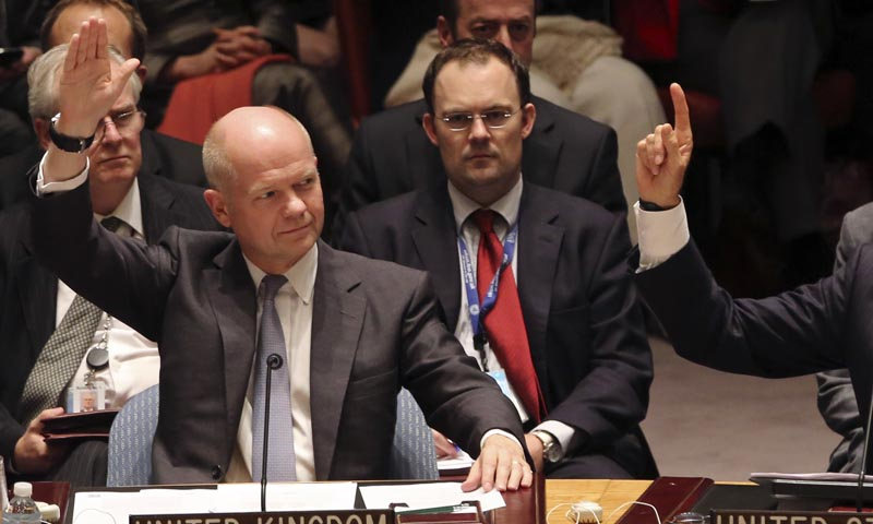British Foreign Minister William Hague votes to approve a resolution that will require Syria to give up its chemical weapons during a Security Council meeting on the situation in Syria, Friday, Sept. 27, 2013 at U.N. headquarters. — Photo by AP