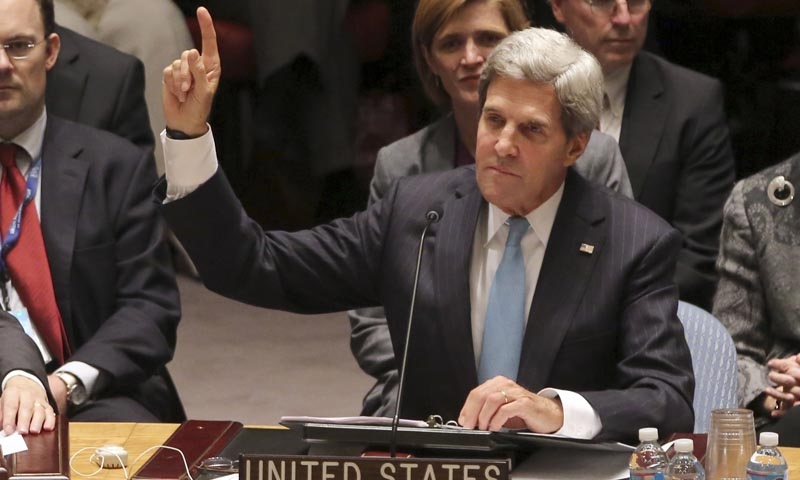 U. Secretary of State John Kerry votes to approve a resolution that will require Syria to give up its chemical weapons during a Security Council meeting on the situation in Syria, Friday, Sept. 27, 2013 at UN headquarters. — Photo by AP