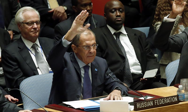 Russian Foreign Minister Sergei Lavrov votes in favor  of a resolution eradicating Syria's chemical arsenal during a Security Council meeting amid the 68th United Nations General Assembly in New York on September 27, 2013.    — Photo by Reuters