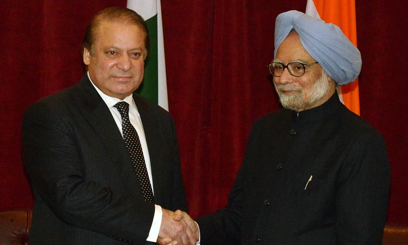 Prime Minister Nawaz Sharif shaking hands with Indian Prime Minister Manmohan Singh prior to their meeting.— Photo by Online