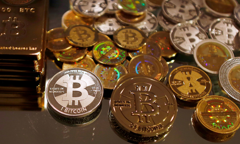 Bitcoins created by enthusiast Mike Caldwell are seen in a photo illustration at his office in Sandy, Utah, September 17, 2013. — Reuters Photo