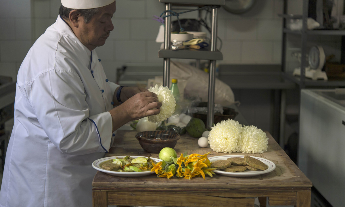 Chef Don Chon serves a plate of ant eggs and chrysanthemums and mosquito eggs with nopal (cactus leaves) and pumpkin flowers.