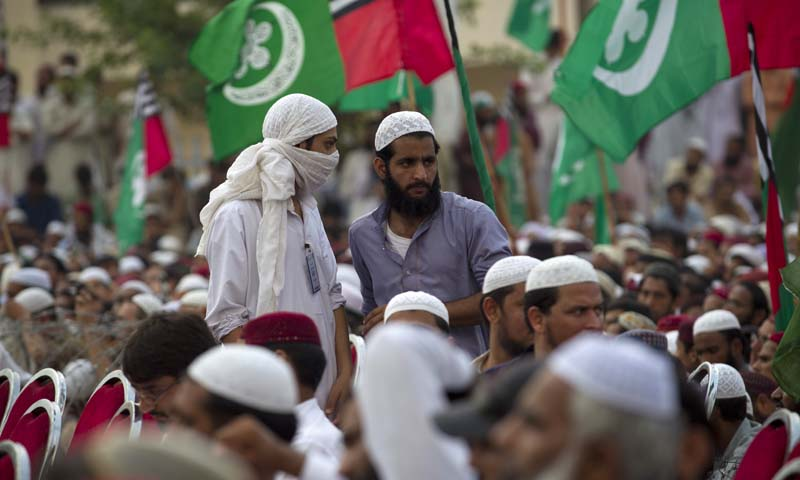 Supporters of Ahle Sunnat Wal Jamaat (ASWJ) listen to their leaders during a gathering to observe the anniversary of banned Sipah-i-Sahaba Pakistan (SSP) organisation's leader Azam Tariq assassinated in 2003, Friday, Oct. 4, 2013 in Islamabad, Pakistan. — Photo by AP