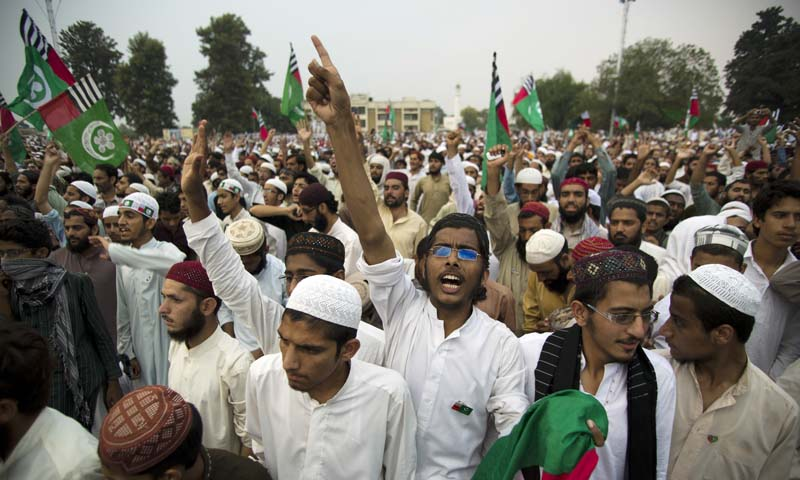 Supporters of Ahle Sunnat Wal Jamaat (ASWJ) shout slogans in favor of banned Sipah-i-Sahaba Pakistan (SSP) organisation's  leader Azam Tariq who was assassinated in 2003, during his anniversary on Friday, Oct. 4, 2013 in Islamabad, Pakistan. — Photo by AP