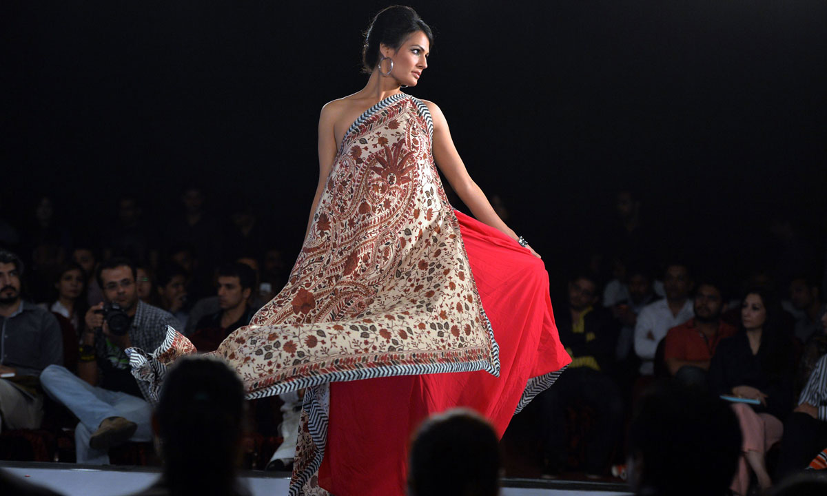 A Pakistani model presents a creation by Gul Ahmed on the last day of the Islamabad Fashion Week. – Photo by AFP