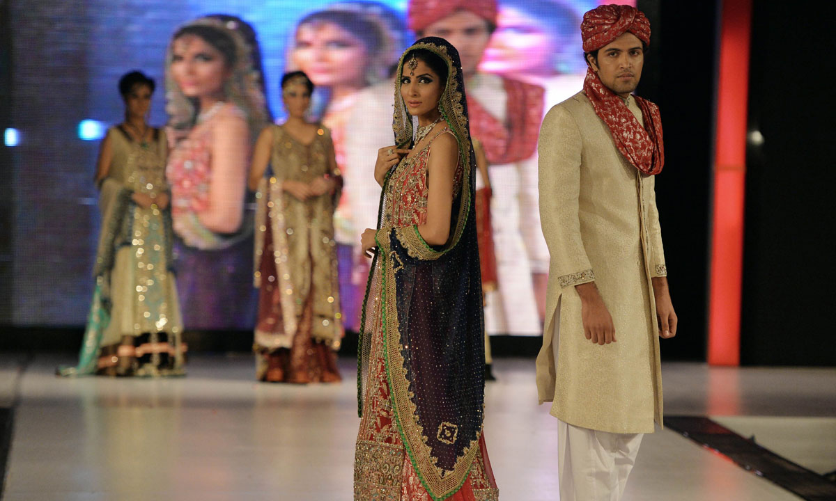 Models present creations by Pakistani designer Erum Khan on the last day of the Islamabad Fashion Week. – Photo by AFP