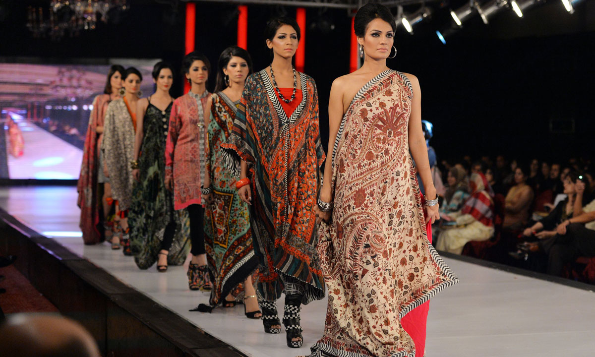 Pakistani models present creations by Gul Ahmed on the last day of the Islamabad Fashion. – Photo by AFP