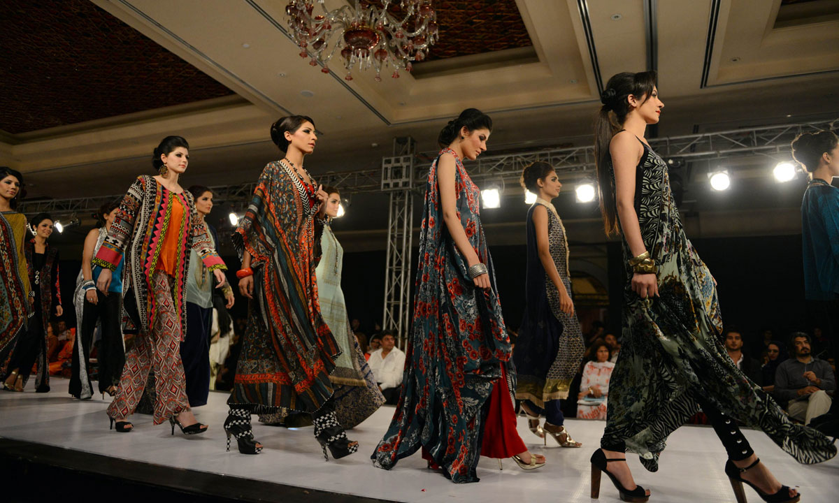 Pakistani models present creations by Gul Ahmed on the last day of the Islamabad Fashion Week. – Photo by AFP