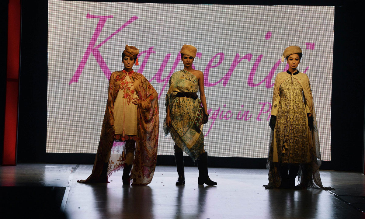 Pakistani models present creations by Kayseria on the last day of the Islamabad Fashion Week. – Photo by AFP