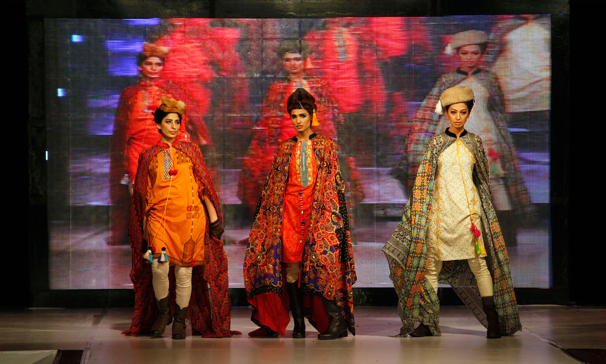 Pakistan models present creations by designer Sobia Zuha during Islamabad Fashion Week. – Photo by AP