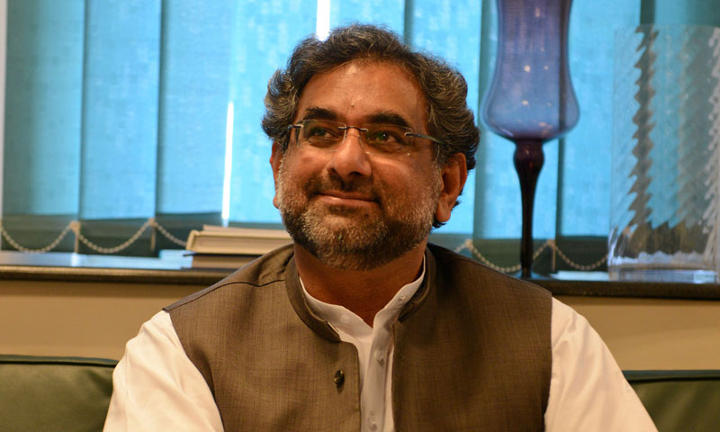 Pakistani Petroleum Minister Shahid Khaqan Abbasi talks with media representatives at his office in Islamabad on October 8, 2013. – AFP Photo