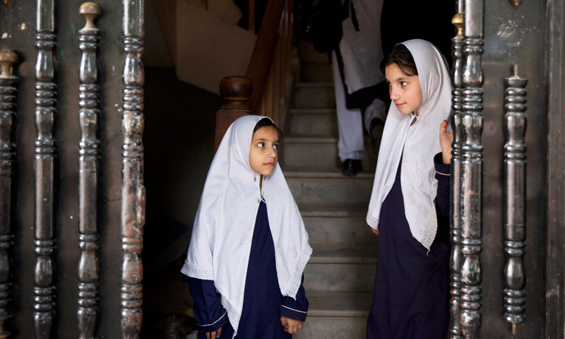Students arrive for class at Malala Yousufzai's old school in Mingora, Swat. -Photo by AP