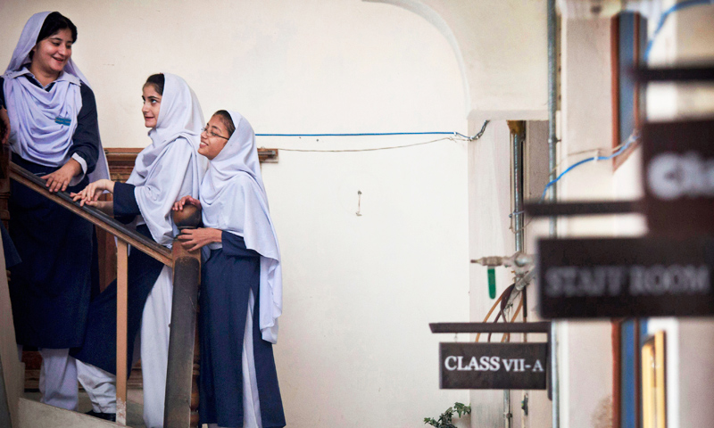 Students get ready for class at Malala Yousufzai's old school in Mingora, Swat. As Malala's fame increases, so do the fears among the students that another Taliban attack might occur. -Photo by AP