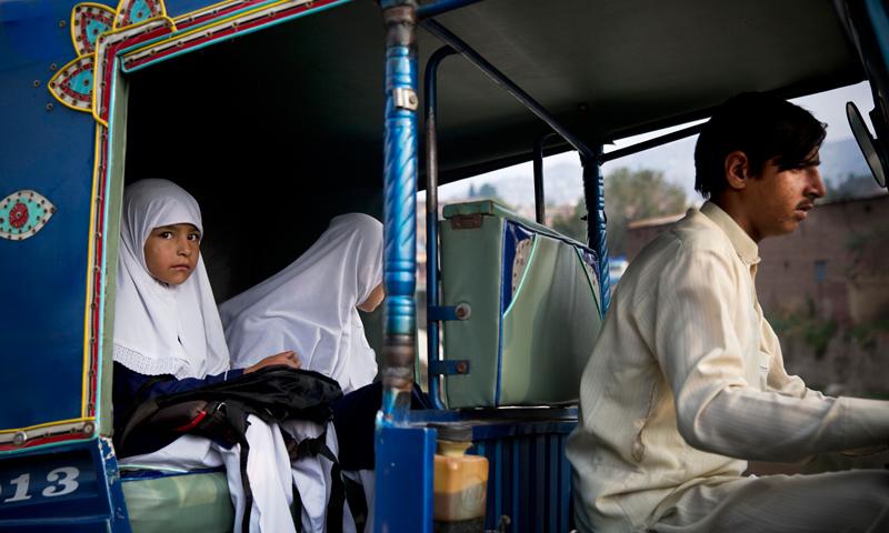 Girls get a ride in a Rickshaw on their way to school in Mingora, Swat. -Photo by AP