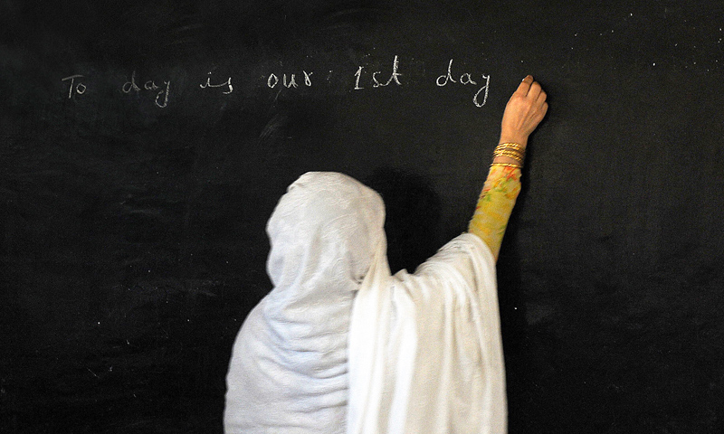 A teacher gives a lesson at a girl's school in Mingora, Swat. -Photo by AFP