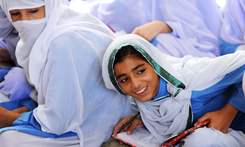 Female students attend a class at a school in Mingora, the capital of Swat Valley. -Photo by AFP