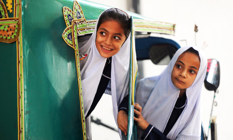 Students sit in an auto-rickshaw as they leave the school of child activist, Malala Yousafzai in Mingora, Swat. -Photo by AFP