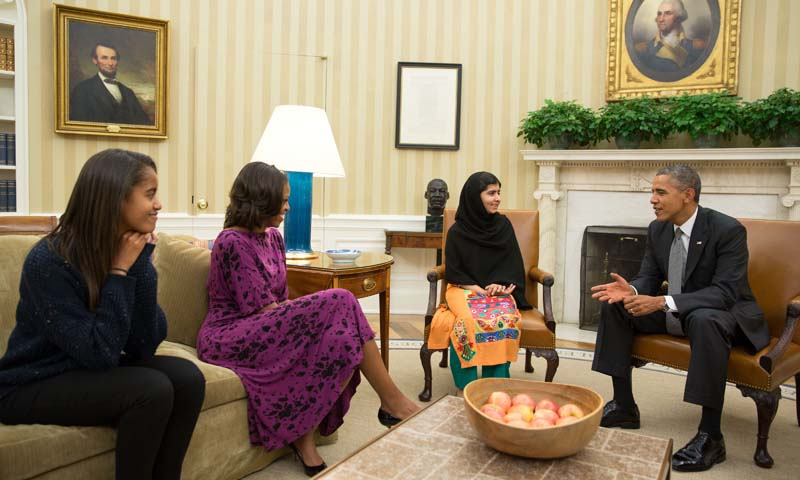 This official White House photo showsPresident Barack Obama, First Lady Michelle Obama, and their daughter Malia meet with Malala Yousufzai, the young Pakistani schoolgirl who was shot in the head by the Taliban a year ago, in the Oval Office, October 11, 2013. — Photo by AFP