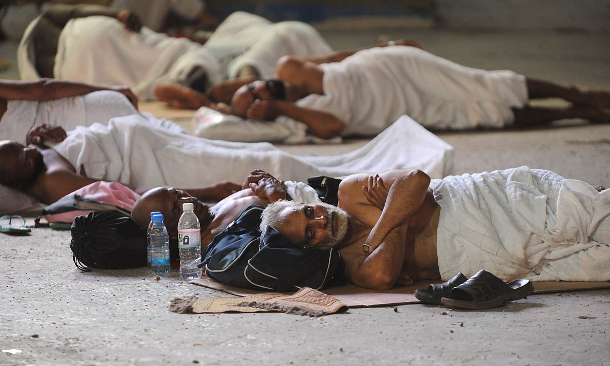 Pilgrims sleep on ground as they wait to perform the morning prayer in Mecca's Grand Mosque. – Photo by AFP