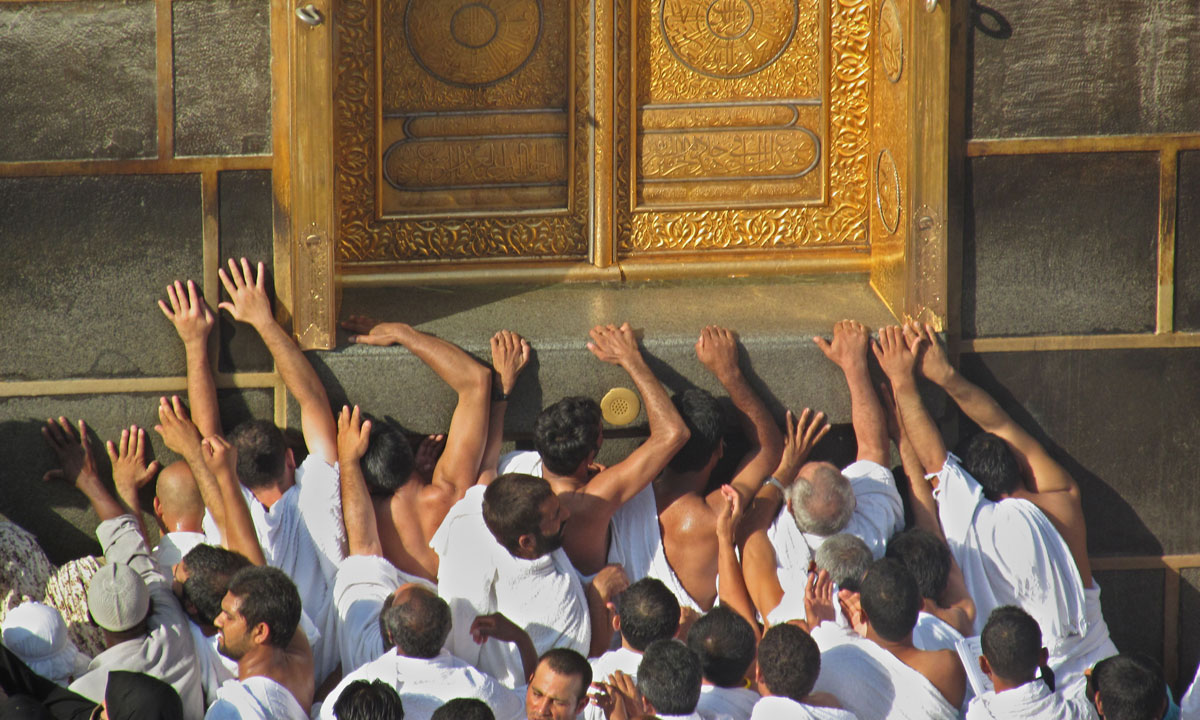 Pilgrims pray at the door of the Kaaba. – Photo by AP