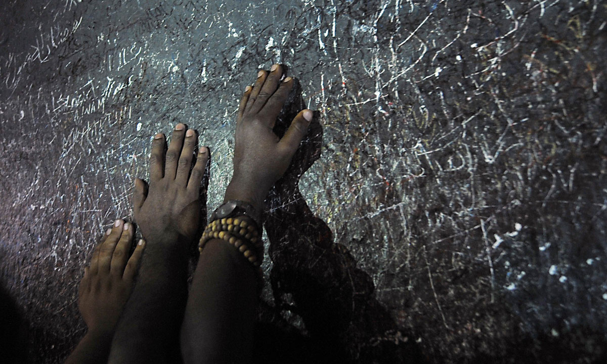 Piligrims touch a rock as they pray on Mount Arafat, near the holy city of Mecca, ahead of the main hajj ritual. – Photo by AFP