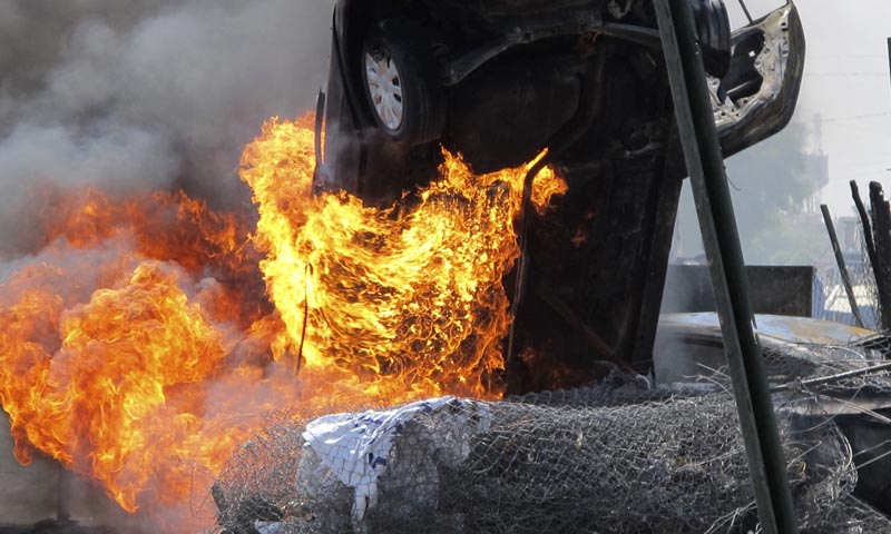 A vehicle burns at the scene of a car bomb attack - File photo